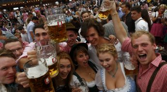 Visitors cheer with mugs of beer during the opening day the 180th Oktoberfest in Munich September 21, 2013. Millions of beer drinkers from around the world will come to the Bavarian capital over the next two weeks for the 180th Oktoberfest, which starts today and runs until October 6.                 REUTERS/Michaela Rehle (GERMANY  - Tags: ENTERTAINMENT SOCIETY)