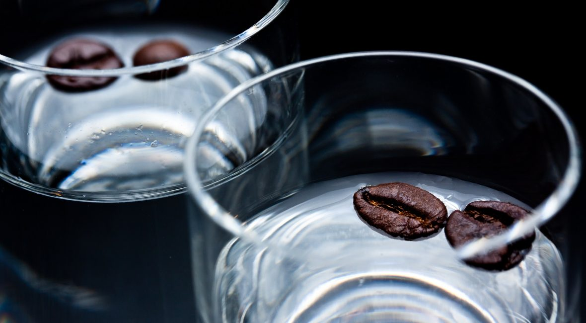 glasses of sambuca with some  coffee beans